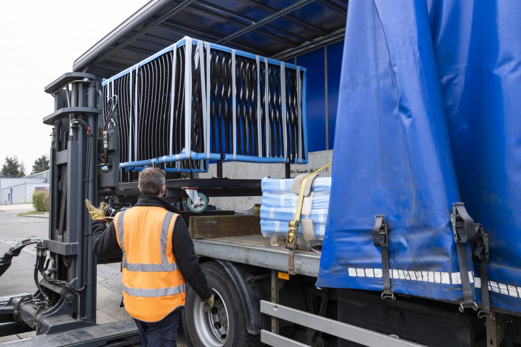 Banksman directing loading of balcony onto lorry