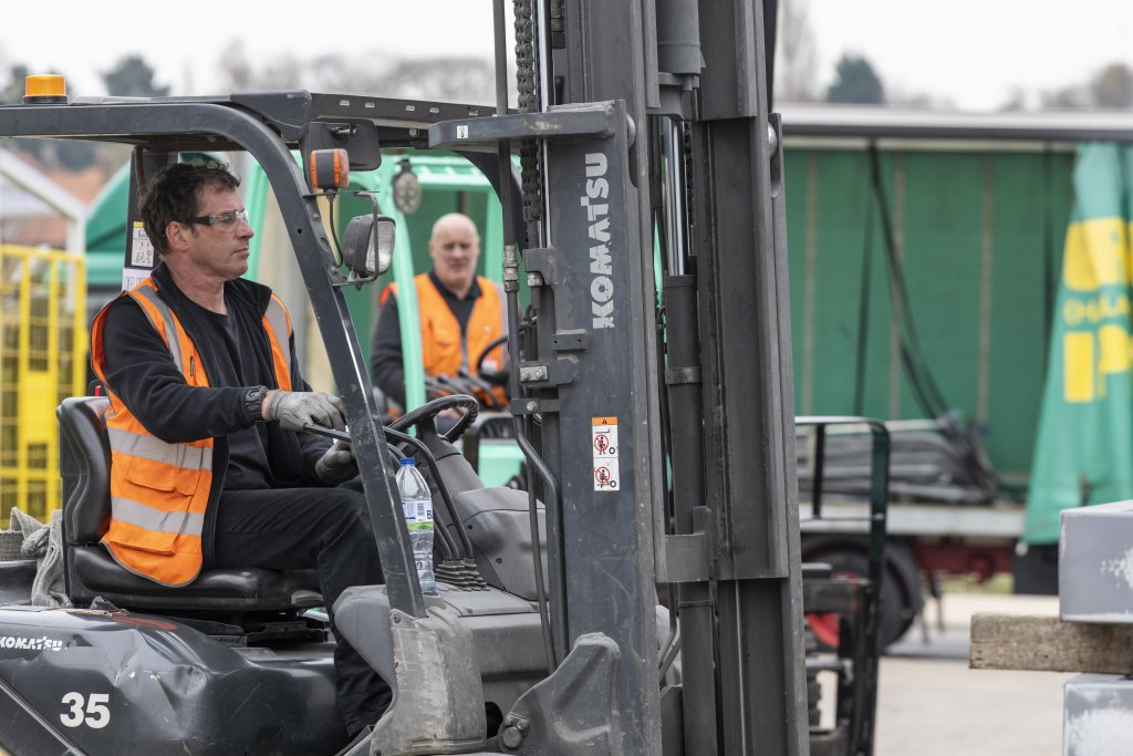 Two fork-lift operatives in action