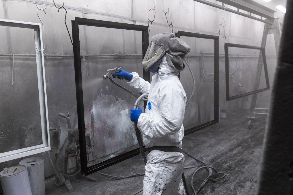 Wet spray opertive coating window frames