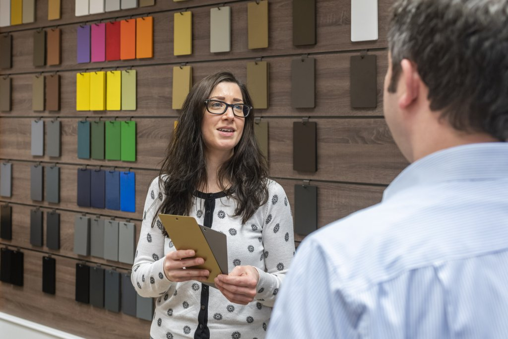 Marketing personnel discussing colour samples with client